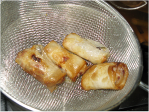 Scoop up the cooked spring rolls
